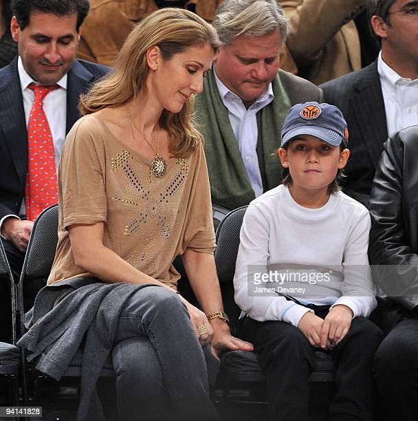 Celine Dion and son Rene Charles Angelil attend the Portland Trailblazers Vs. New York Knicks game at Madison Square Garden on December 7, 2009 in...