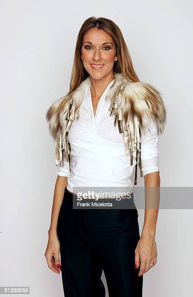 Celine Dion poses for a picture backstage during the 2004 World Music Awards at the Thomas and Mack Center on September 15 2004 in Las Vegas Nevada