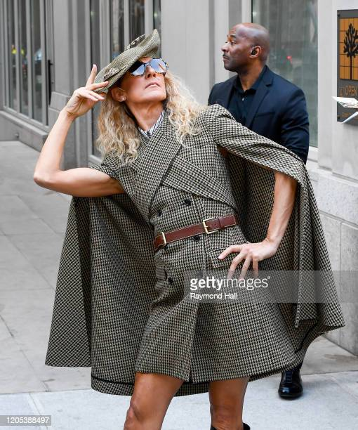 Celine Dion poses for photos on the street in Soho on March 5, 2020 in New York City.