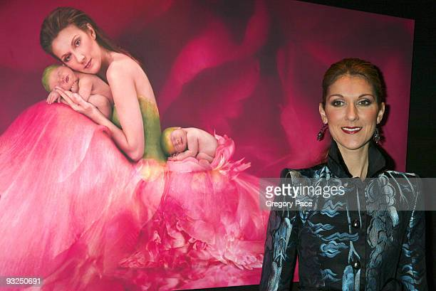 Celine Dion poses in front of the Anne Geddes photo of her