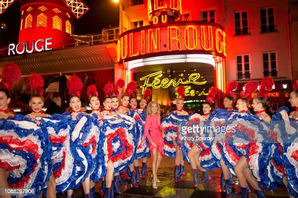 Celine Dion poses with dancers during her visit to The Moulin Rouge on January 24 2019 in Paris France