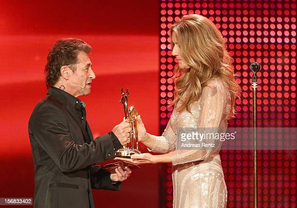 Celine Dion receives a Bambi from Peter Maffay during the 'BAMBI Awards 2012' at the Stadthalle Duesseldorf on November 22 2012 in Duesseldorf Germany