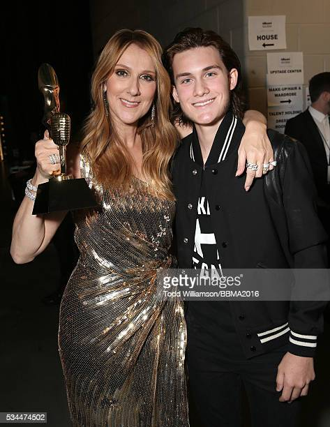 Celine Dion recipient of the Billboard Icon Award and son ReneCharles Angelil backstage at the 2016 Billboard Music Awards at the TMobile Arena on...