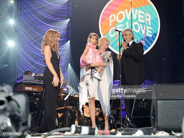 Celine Dion Sharon Stone holding Andrea Bocelli's daughter Virginia Bocelli and Andrea Bocelli appear on stage during the 19th annual Keep Memory...