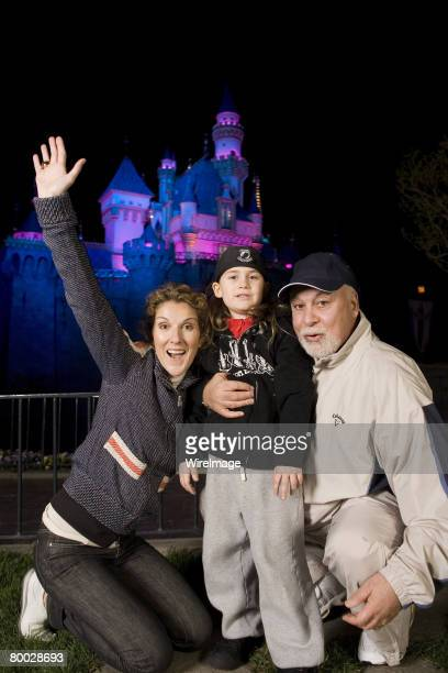 Celine Dion son ReneCharles and husband Rene Angeli outside Sleeping Beauty Castle at Disneyland in Anaheim Calif on Wednesday night Dion and her...