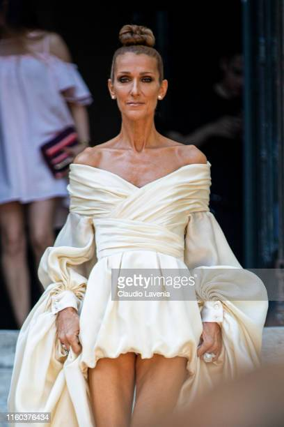 Celine Dion, wearing a cream maxi dress, is seen outside Alexandre Vauthier show during Paris Fashion Week - Haute Couture Fall/Winter 2019/2020 on...