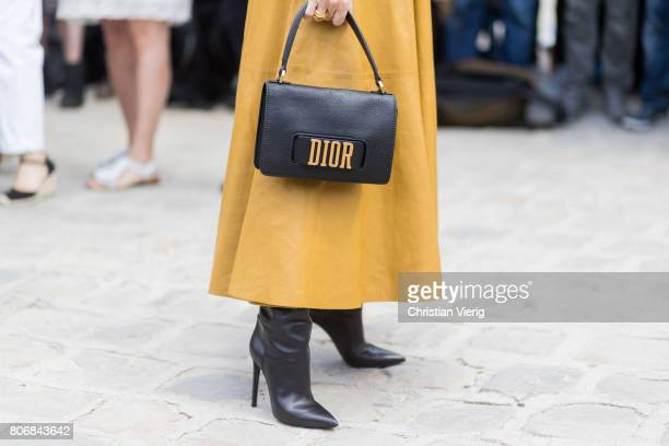 Celine Dion wearing Dior bag outside Dior during Paris Fashion Week Haute Couture Fall/Winter 20172018 Day Two on July 3 2017 in Paris France
