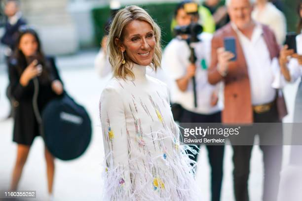 Celine Dion wears a white fluffy dress with turtleneck outside Valentino during Paris Fashion Week Haute Couture Fall/Winter 2019/2020 on July 03...