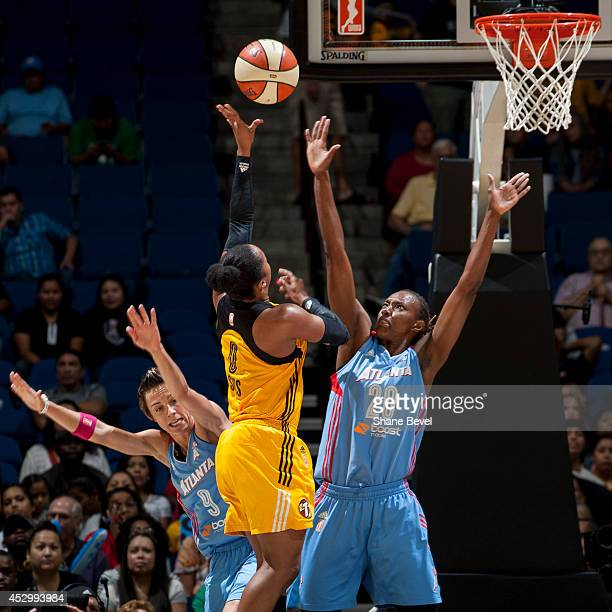 Celine Dumerc and Sancho Lyttle of the Atlanta Dream defends against Odyssey Sims of the Tulsa Shock during the WNBA game on July 31 2014 at the BOK...
