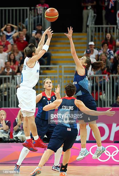 Celine Dumerc of France shoots the go ahead basket over Johannah Leedham Natalie Stafford and Stef Collins of Great Britain in the final moments of...