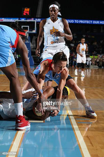 Celine Dumerc of the Atlanta Dream and Jessica Breland of the Chicago Sky battle for the ball on August 10 2014 at the Allstate Arena in Rosemont...