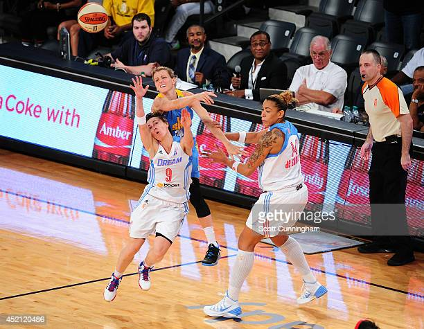 Celine Dumerc of the Atlanta Dream battles for a loose ball against Allie Quigley of the Chicago Sky on July 13 2014 at McCamish Pavilion in Atlanta...