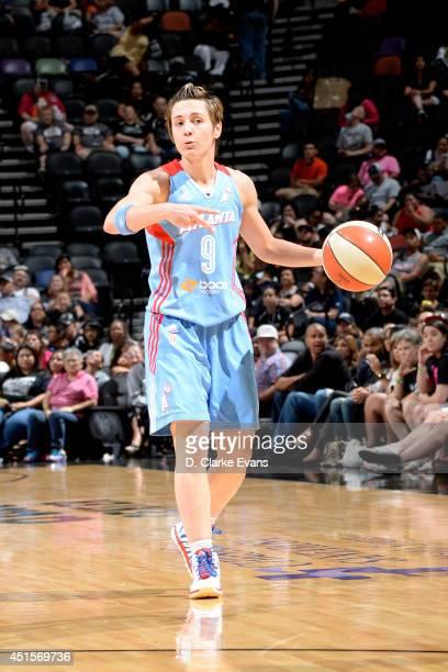 Celine Dumerc of the Atlanta Dream calls a play during a game against the San Antonio Stars at the ATT Center on June 26 2014 in San Antonio Texas...