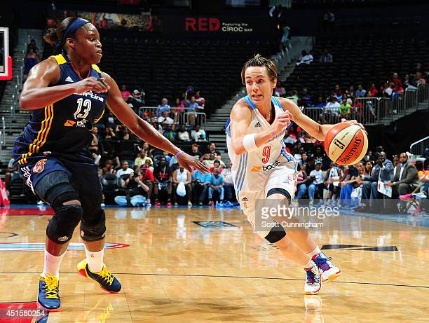 Celine Dumerc of the Atlanta Dream drives against Karima Christmas of the Indiana Fever on July 1 2014 at Philips Arena in Atlanta Georgia NOTE TO...