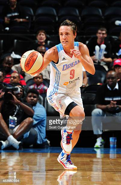 Celine Dumerc of the Atlanta Dream drives against the Chicago Sky in Game One of the Eastern Conference Semifinals during the 2014 WNBA Playoffs on...