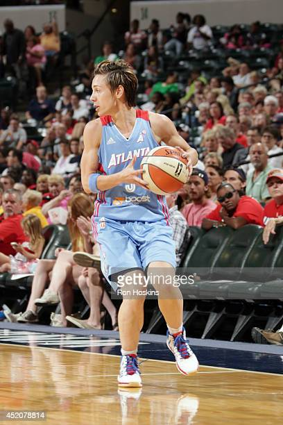 Celine Dumerc of the Atlanta Dream drives against the Indiana Fever on July 12 2014 at Bankers Life Fieldhouse in Indianapolis Indiana NOTE TO USER...