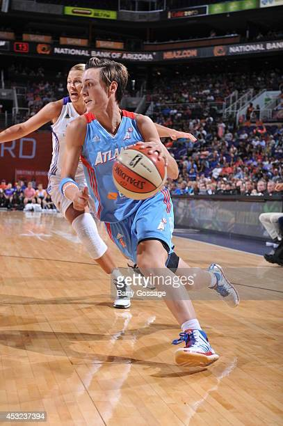 Celine Dumerc of the Atlanta Dream drives to the basket against the Phoenix Mercury on August 5 2014 at US Airways Center in Phoenix Arizona NOTE TO...