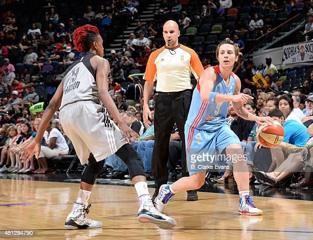 Celine Dumerc of the Atlanta Dream handles the ball against Danielle Robinson of the San Antonio Stars at the ATT Center on June 26 2014 in San...