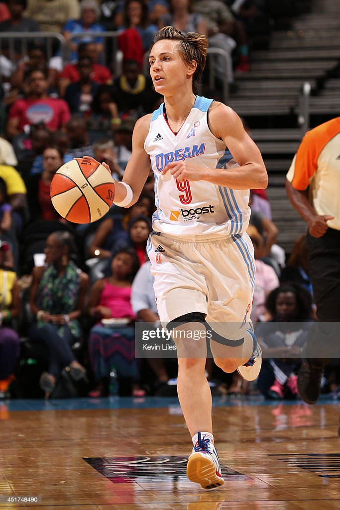Celine Dumerc #9 of the Atlanta Dream handles the ball against the Washington Mystics at Philips Arena on July 5, 2014 in Atlanta, Georgia.