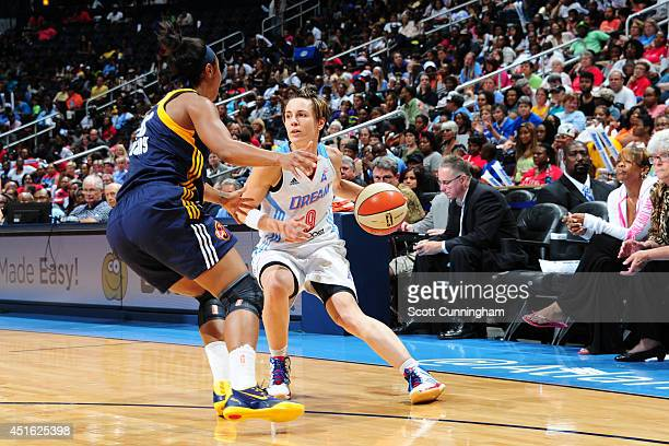 Celine Dumerc of the Atlanta Dream handles the ball against the Indiana Fever on July 1 2014 at Philips Arena in Atlanta Georgia NOTE TO USER User...