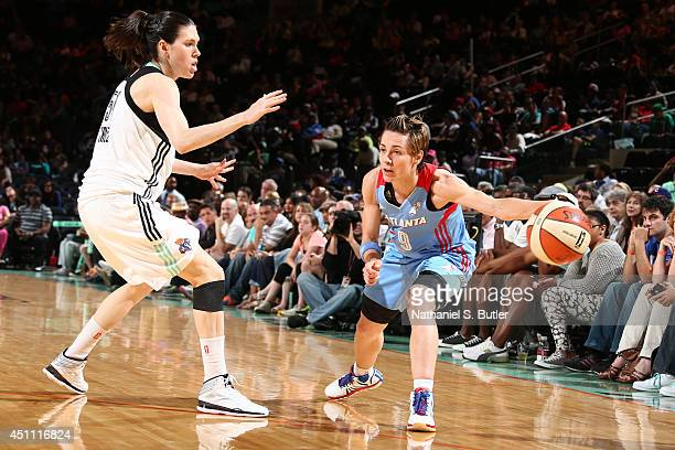 Celine Dumerc of the Atlanta Dream looks to pass against the New York Liberty during a game at Madison Square Garden in New York City on June 22 2014...