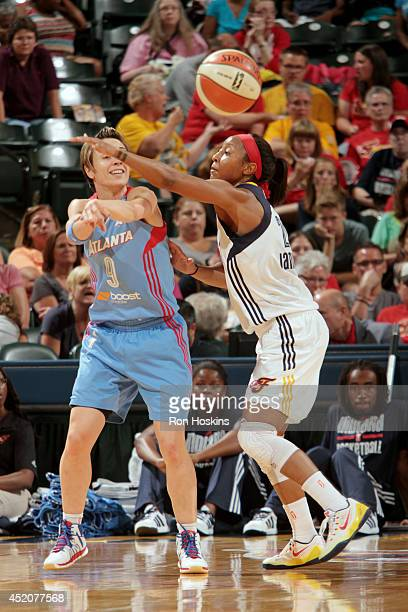 Celine Dumerc of the Atlanta Dream passes the ball against the Indiana Fever on July 12 2014 at Bankers Life Fieldhouse in Indianapolis Indiana NOTE...