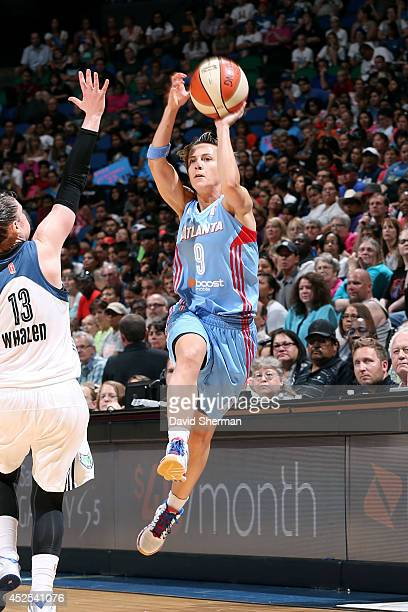 Celine Dumerc of the Atlanta Dream shoots against Lindsay Whalen of the Minnesota Lynx during the WNBA game on July 22 2014 at Target Center in...