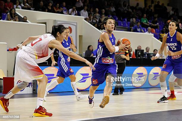 Celine Dumerc of the French Basketball Women's National Team drives to the basket against Lu Weng of the Chinese Basketball Women's National Team...