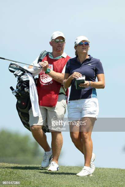 Celine Herbin of France and caddie walk on the first hole during the first round of the Marathon LPGA Classic golf tournament at Highland Meadows...