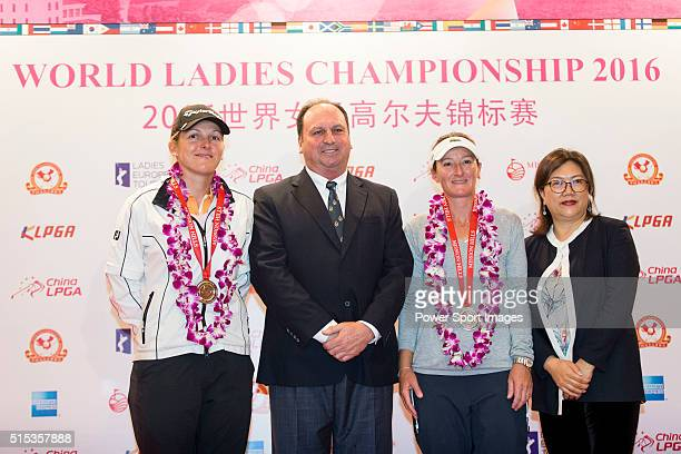 Celine Herbin of France and Gwladys Nocera of France receive the team runnersup medal from the hands of Iain Roberts and Jennifer Lee during the...