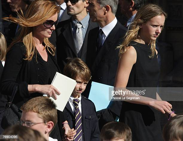 Celine Martin Clovis Martin and Juliette Martin leave the Cathedral St Jean after the French TV star Jacques Martin's funeral on September 20 2007 in...
