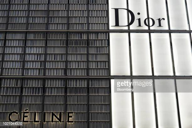 A Celine SA store left and a Christian Dior SE store stand in the Ginza area of Tokyo Japan on Tuesday Aug 21 2018 Japan is scheduled to release...
