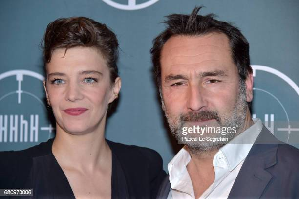 Celine Salette and Gilles Lellouche attend 'HHHH' Paris Premiere at Cinema UGC Normandie on May 9 2017 in Paris France