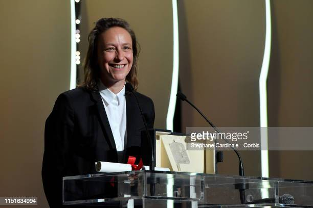 Celine Sciamma receives the Best Screenplay award for her film Portrait de la Jeune Fille en Feu on stage during the Closing Ceremony of the 72nd...