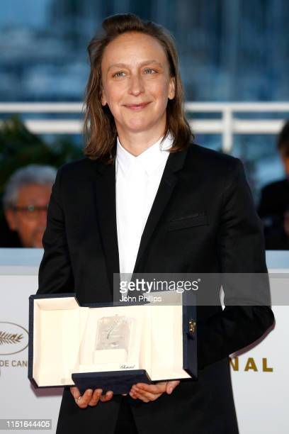Celine Sciamma winner of the Best Screenplay award for her film Portrait de la Jeune Fille en Feu poses at thewinner photocall during the 72nd...