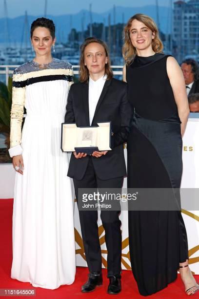 Celine Sciamma winner of the Best Screenplay award for her film Portrait de la Jeune Fille en Feu poses with Noemie Merlant and Adele Haenel at...