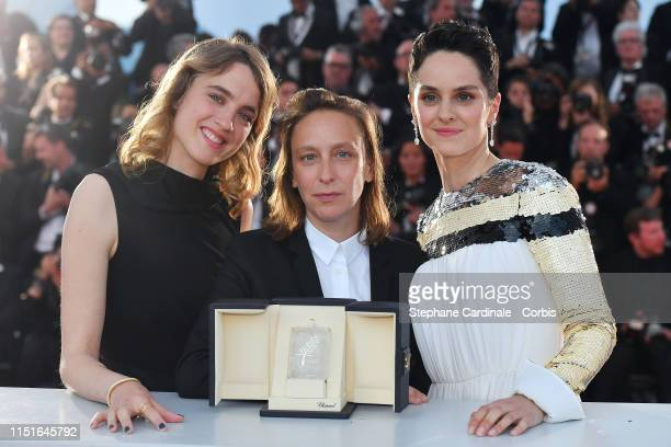 Celine Sciamma winner of the Best Screenplay award for her film Portrait de la Jeune Fille en Feu poses with Noemie Merlant and Adele Haenel at...