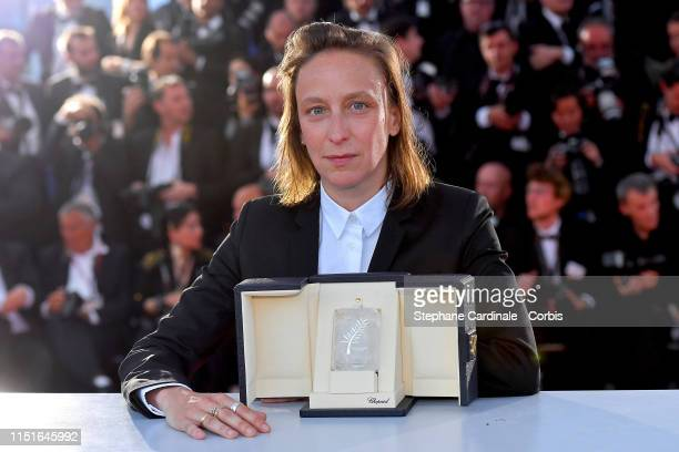 Celine Sciamma winner of the Best Screenplay award for her film Portrait de la Jeune Fille en Feu poses at the winner photocall during the 72nd...