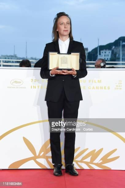 Celine Sciamma winner of the Best Screenplay award for her film Portrait de la Jeune Fille en Feu poses at thephotocall for Palme D'Or Winner during...