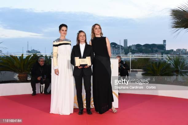 Celine Sciamma with Noemie Merlant and Adele Haenel winner of the Best Screenplay award for her film Portrait de la Jeune Fille en Feu poses at...