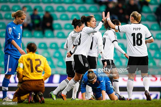 Celja Sasic and Alexandra Popp of Germany celebrate with teammates after scoring during the FIFA Women's World Cup 2015 Qualifier between Slovakia...