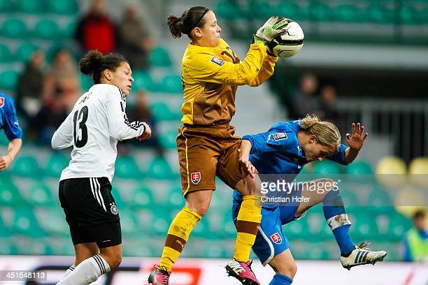 Celja Sasic of Germany challenges goalkeeper Maria Korenciova and Lenka Mravikova of Slovakia during the FIFA Women's World Cup 2015 Qualifier...