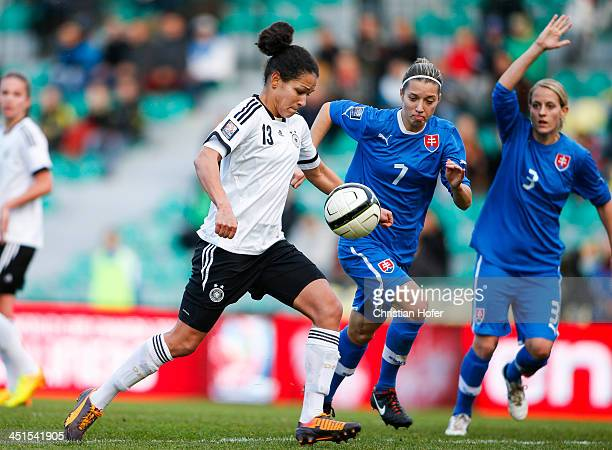 Celja Sasic of Germany competes for the ball with Patricia Fischerova of Slovakia during the FIFA Women's World Cup 2015 Qualifier between Slovakia...