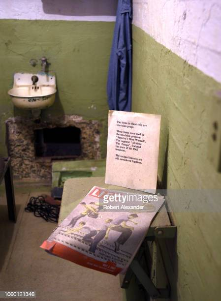 SAN FRANCISCO CALIFORNIA SEPTEMBER 12 2018 A cell at the former Alcatraz Federal Penitentiary on Alcatraz Island in San Francisco Bay contains props...