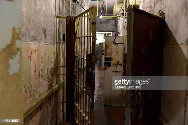 COLLIER Cell doors are seen behind a lattice door in the basement of the 'Stura maja' or 'Corner house' the former headquarters of the Soviet KGB in...