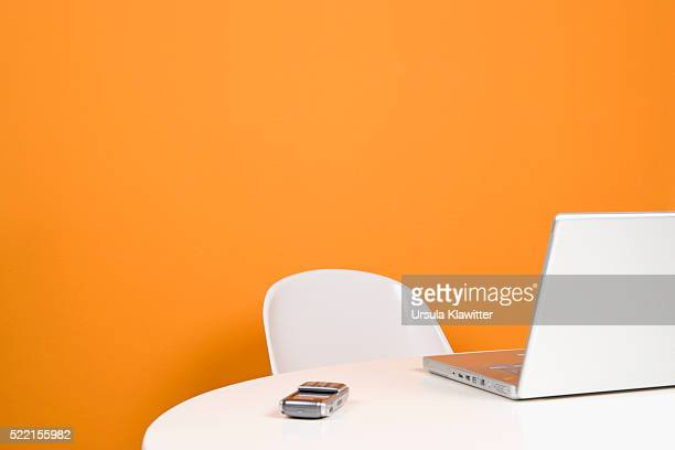Cell Phone and Laptop on Table