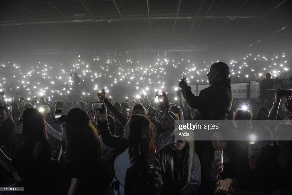 Cell phone flashlights during a concert.