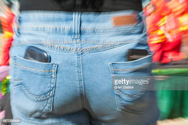 Cell phone in both back pockets