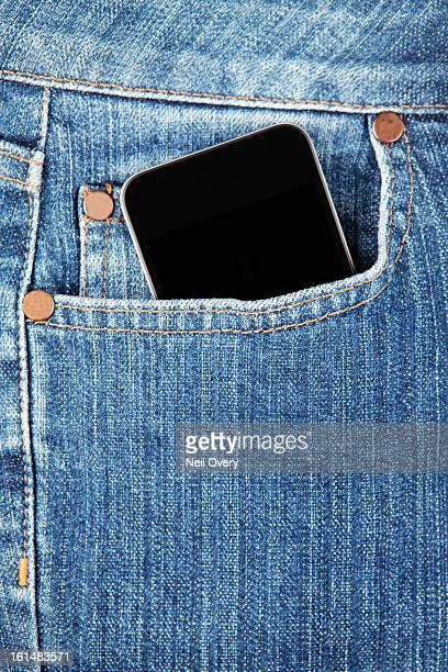 Cell phone in denim jeans pocket