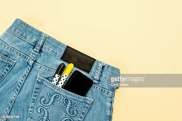 Cell phone in jeans pocket
